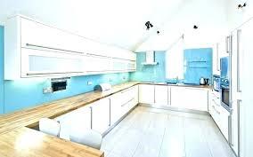 blue glass backsplash blue glass kitchen white kitchen blue glass modern kitchen with white cabinetry and