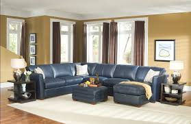 interior design ideas for traditional living room with navy blue leather sectional sofa and elegant brown curtains