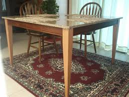 beautiful dining table supported by tapered oak dining table legs
