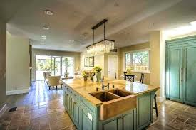 green countertop turquoise cabinets a exotic with copper a front sink a linear glass chandelier over