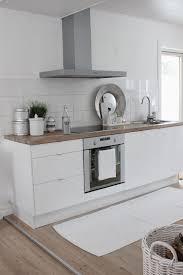 White Kitchen Tiles 13 Tiny White Contemporary Kitchen With Wooden Countertop No