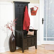 entrance furniture. Black Wood Finish Corner Bench With Cloth Hamger On Top An Artisic Dark Vase Beautiful Entrance Furniture