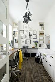small home office with bookshelves black and white frame collage