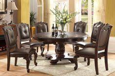 kiera round dining room set