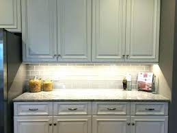 white kitchen cabinets with glass tile backsplash grey tile designs white cabinets white kitchen cabinets glass