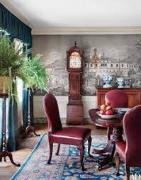 in a los angeles house designed by michael s smith a gracie wallpaper depicting views of the turkish coastline animates the dining room which is