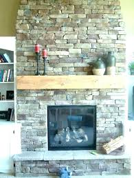 stacked stone over brick stone and brick fireplace designs faux stone fireplace how to put stone