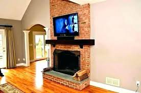 mounting tv above fireplace hiding wires hang over fireplace great installation