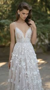a line wedding dress with spagetti straps a sweetheart neckline and fl appliques