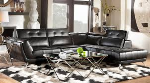 Black and white chairs living room Contemporary Living Novello Living Room Set Black Leather Sectional With Glasstop Metal Tables On Beige Black And White Elle Decor Beige Black White Living Room Furniture Decorating Ideas