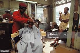 Barber Ivan Boyd cuts the hair of young Bryson Smith at his shop in... News  Photo - Getty Images