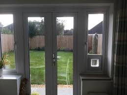 i ve just had a cat flap fitted into a window appaly because the doors are triple glazed it would have been very difficult to fit one in the door as
