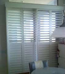 bypass shutters for sliding glass doors medium size of manual roll down hurricane cost