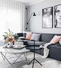 dark grey sofa with marble coffee table and dramatic art dark t98