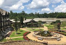 the rustic lodge at callaway overlooks the spa and water feature on one side the pool and beach on the other