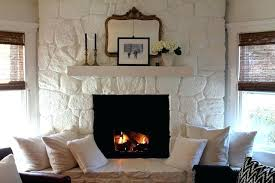 stone fireplace painted white painted stone fireplace favorite white paint color cloud white stacked stone fireplace