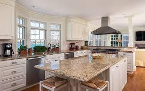 kitchen with white cabinets and giallo ornamental granite countertops
