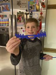 Nick Smith of Midland makes 115 face mask strap holders with 3D printer -  Midland Daily News