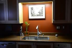 sink lighting. Ceiling Lighting Fixture For Modern Sink And Faucet A Kitchen Set With Storage Luxurious E