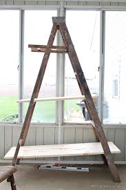 create shelving out of an old antique ladder with this easy tutorial for details