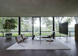 above johnson s living room furniture is by his friend ludwig mies van der rohe the glass house itself was directly inspired by a model of mies s