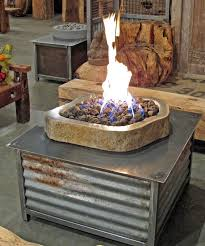 limited edition square reclaimed steel fire table with natural andesite stone fire pit area for burning propane or natural gas standard propane tank fits