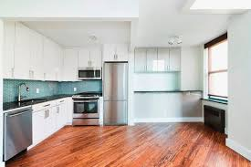 laminate wood flooring in kitchen. Unique Kitchen White Kitchen Cabinets With Stainless Steel Appliances Laminate Flooring   For Wood Flooring In Kitchen E