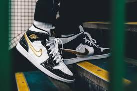 air jordan 1 mid se black white gold on feet