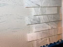 Marble slab backsplash Carrara Marble Add Sheets Of Tile Hgtvcom How To Install Marble Tile Backsplash Hgtv