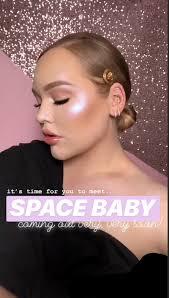 nikkietutorials teases e baby highlighter from ofra cosmetics electro glaze makeup collab
