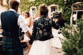 bride in yolan cris lace gown leather jacket outdoor destination wedding at château de