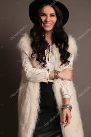 woman wears luxurious fur coat stock photo