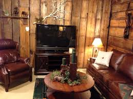 relaxing living room decorating ideas. Classic Barn Wooden Round Coffee Table Decors With Old Brown Leather Sofa And White Cushion Relaxing Living Room Decorating Ideas