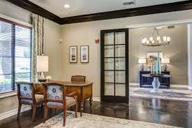 office french doors. Multi Family Apartment Community Leasing Office With Light Brown Furniture, Wall Art, And Black French Doors