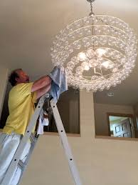 a professional chandelier maintaining