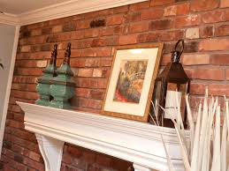 brick wall with traditional white mantel and accessories