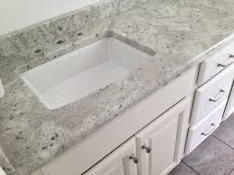 andromeda white granite vanity top on a medallion columbia divinity white vanity with a