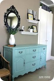 hanging shelves above a dresser with mirror and storage dresser with shelves