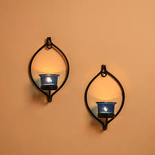 set of 2 decorative black eye wall sconce candle holder with blue glass and free t light candles