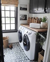 Black/White/Wood - Laundry room with black and white cement tiles ...