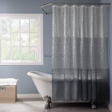 beach style bathroom design with freestanding tubs and curved shower curtain rod with gray shower curtains
