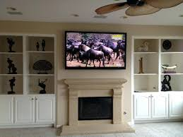 smlf install tv over fireplace wiring living room ceiling fan mounting bookcase decor flat screen stone brick
