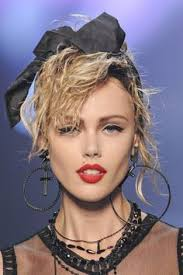 let s start off our list with a softer clic 80 s madonna look besides the 80 s this makeup look also takes inspiration from the 50 s and 60 s with the