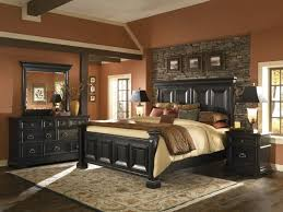 traditional furniture traditional black bedroom. Stone Accent Wall For Traditional Bedroom Decorating Style With Amazing Wooden Bed Frame And Sandy Coral Color Furniture Black I