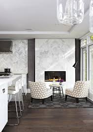 exquisite contemporary kitchen fetaures a sconversation zone next to the fireplace with calacatta marble surround