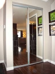 Interior:Elegant Mirrored Closet Doors Design With Brown Wooden Flooring  And High Black Bar Stool