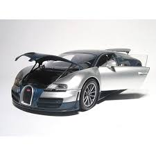 A sportier veyron that offered a more extreme driving experience, the bugatti veyron super sport unveiled in 2010 at the monterey motorsports reunion was the fastest thing on wheels at the time. 2011 Bugatti Veyron Super Sport In Blue Tinted Carbon Silver By Minichamps In 1 18 Scale Walmart Com Walmart Com
