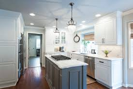 Transitional U Shaped Kitchen With White Perimeter Cabinets And A
