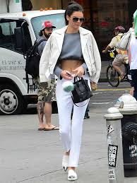 how to wear white leather biker jacket grey cropped sweater white skinny pants