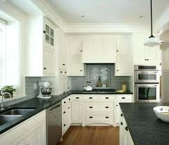 white cabinets gray subway tile dark counters backsplash for black countertops kitchen with granite